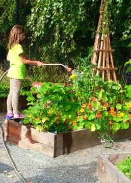 Lisa Watering Her Class' Garden